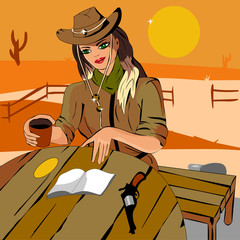 Girl in a cowboy hat, reading a book at the ranch
