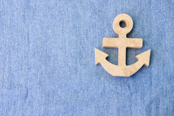 A white wood anchor on fabric for background