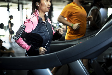 People exercising at fitness gym