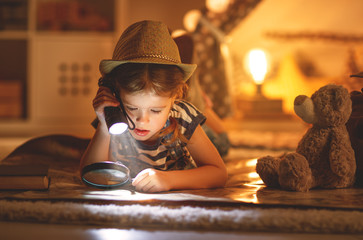 funny child girl tourist with flashlight and world map and backpack and