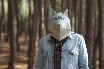 Man with Wolf mask on head.
