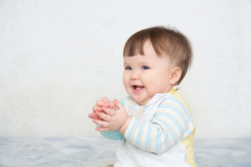 happy clapping hands cute smiling baby, caucasian blue eyes cheerful infant playing funny