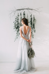 Easy spring bride's morning in the Studio with stylish decor and European-style with fresh greens