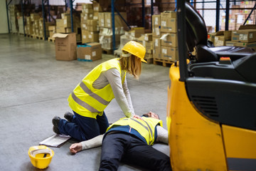 Warehouse workers after an accident in a warehouse.