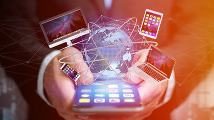 View of a Businessman holding a Computer and devices displayed on a smartphone interface with international network  - 3d render