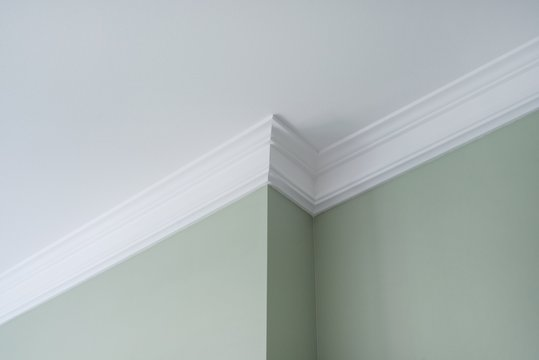 Ceiling moldings in the interior, detail of intricate corner.