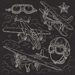 set icons retro old aircraft, pilot helmet and glasses pilot drawn on black background