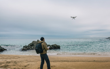 Man  testing its drone and recording videos