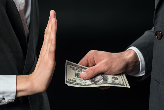 cropped view of businesswoman refusing to take bribe from partner, isolated on black