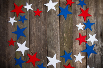 Old wooden background and stars of American flag. Independence or Presidents day.