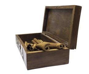 Cinnamon in wooden tea box isolated on white