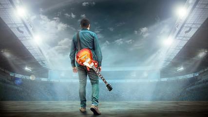 Artist Guitarist hands play on electricity guitar under light, P