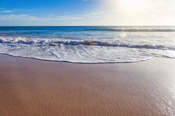 minimalistic sea background, blue ocean, sandy beach, glare of the sun