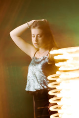 Amazing young woman with long hair wearing fashion outfit posing with mixed light