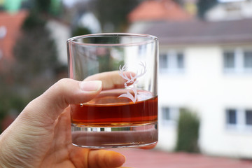 A glass full of ornaments of whiskey