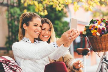 Two women friends taking a selfie