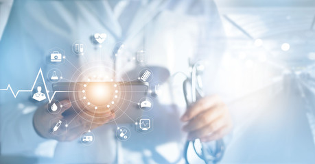 Medicine doctor and stethoscope in hand with icon medical network connection with modern virtual screen interfacein hospital background, medical technology network concept