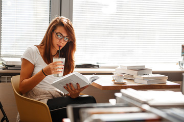Young female student study in the university campus library.