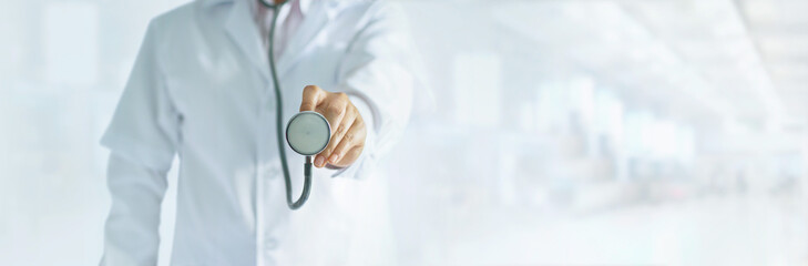 Medicine doctor holding stethoscope in hand on hospital background, medical and patient concept, blank text