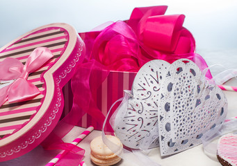 gift for St. Valentine's Day - gift box, ribbon and gingerbread hearts with macaroon