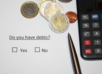 Do you have debts? Question on paper with yes or no box fot thick. European currency coins and calculator and pen.