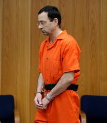 Larry Nassar, a former team USA Gymnastics doctor who pleaded guilty in November 2017 to sexual assault charges, enters the courtroom during his sentencing hearing in the Eaton County Court in Charlotte, Michigan