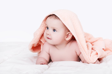 Baby girl or boy after shower with towel on head, isolated