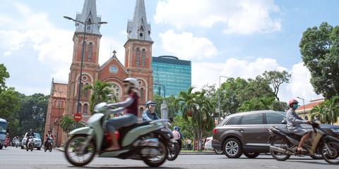 Motorcycles and Notre-Dame Cathedral in Saigon, Vietnam ホーチミンを走るバイクとノートルダム大聖堂