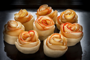 Buns-rosettes on a baking sheet, oiled. Bakery products.