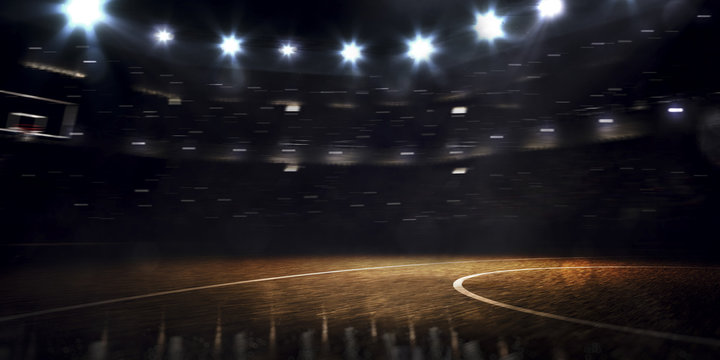 Grand basketball arena in the dark spot light
