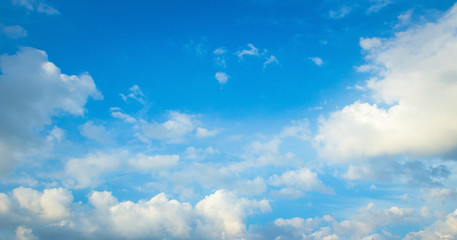 World environment day concept: Blue sky and white clouds with sun light skyline background