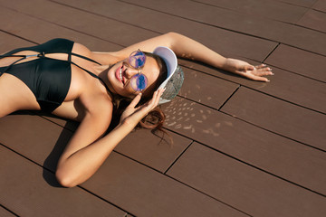 Fashion Woman In Swimsuit Relaxing In Summer.