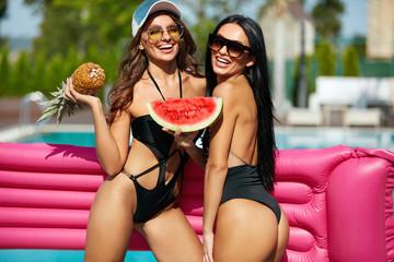 Summer Fashion. Girls In Swimsuits Having Fun Near Pool