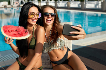Summer Fashion. Girls Having Fun Taking Photos Near Pool.
