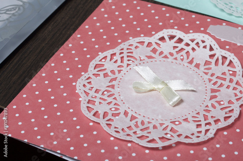 The girl is engaged in making greeting cards at home using paper the girl is engaged in making greeting cards at home using paper lace m4hsunfo