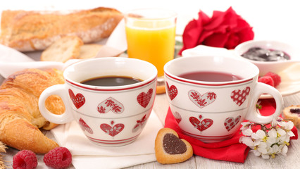 breakfast with coffee, tea,croissant and rose
