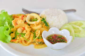 Stir fried squid with curry.