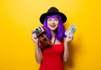 girl with purple hairstyle with money and retro camera