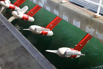 Tidal water turbines in a row above the river waiting for the tide Wall mural