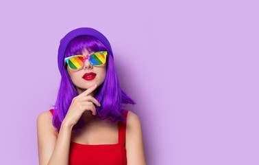 girl with purple hair and rainbow eyeglasses