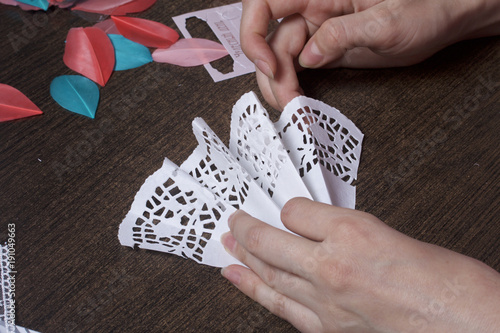The Is Engaged In Making Greeting Cards At Home Using