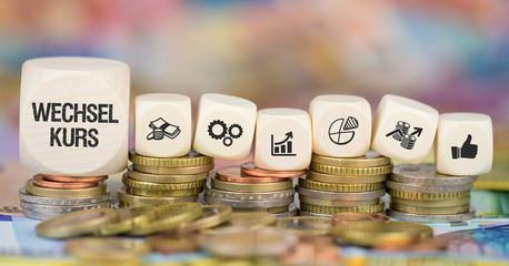 Wechselkurs / Münzenstapel mit Symbole