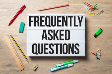 Frequently asked questions written on lightbox lying on floor