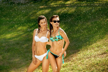 Summer Style. Girls In Swimsuits Having Fun Outdoors