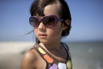Girl with sunglasses on beach