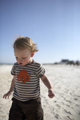 Boy playing in sand at beach