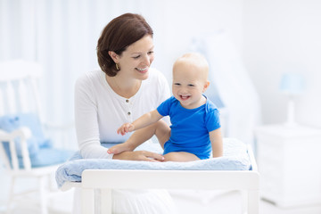 Mother and baby on changing table