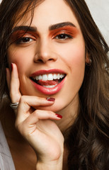 Image of smiling brunette with bright make-up