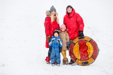 Image of parents with daughter and son on winter walk