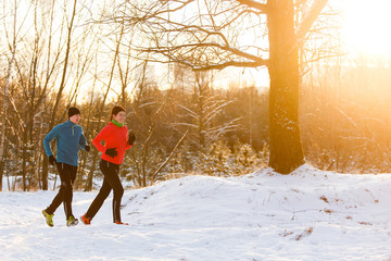 Photo of running athletes in winter forest